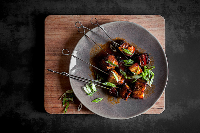 Log fire roasted pork belly skewers - Yuppiechef Magazine