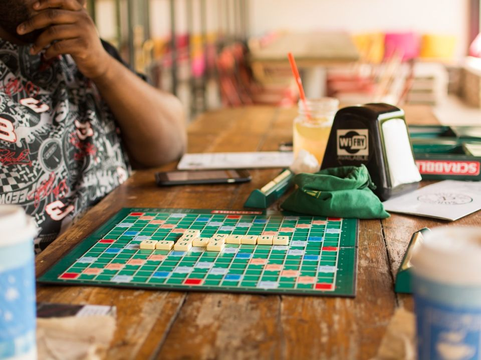 Looking for a different night out that bars and nightclubs? Here's a selection of some of the best board game cafes in Toronto. title image
