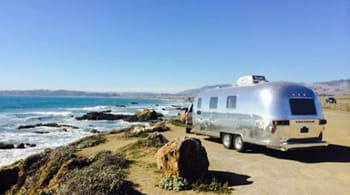 Airstream next to the ocean