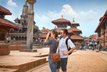 Young caucasian couple looking at temple monuments on holiday happy to avoid travellers diarrhoea