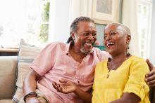 Middle aged black couple smiling because they have found a hormone replacement therapy that works for them