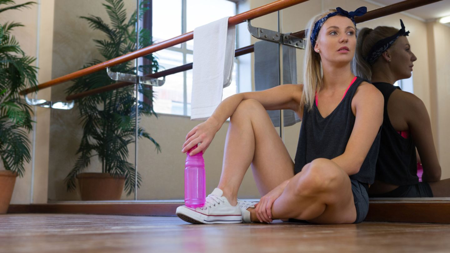 Woman sat on the floor of a dance studio wonder if the pill is affecting her weight loss
