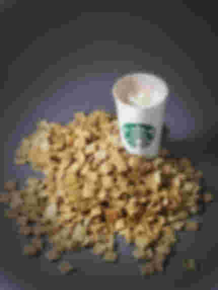 starbucks venti white chocolane mocca with cream next to a pile of grahams
