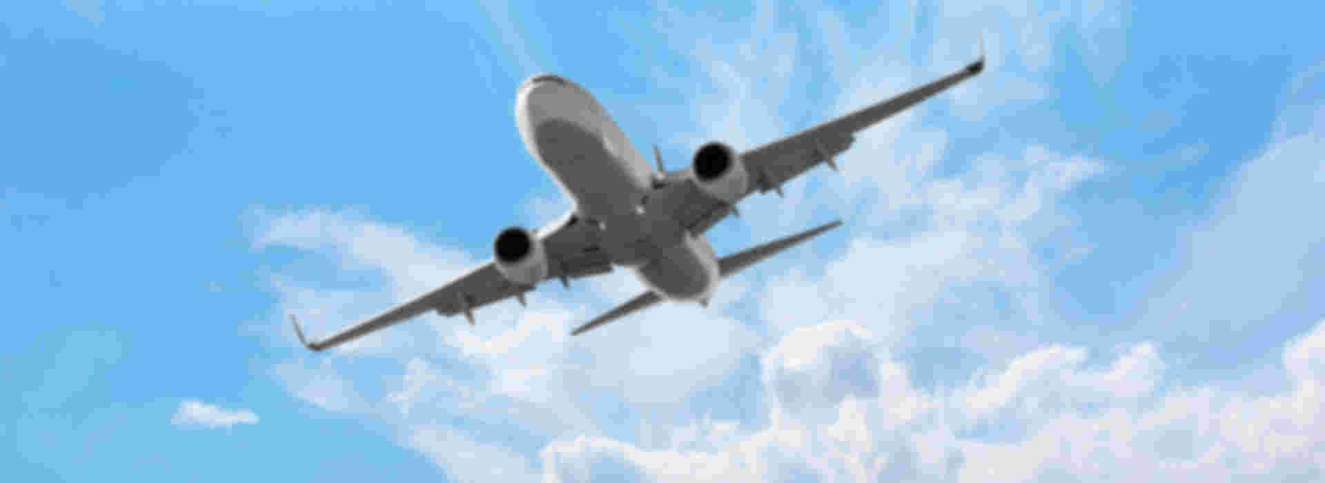 An aeroplane soaring through the skies