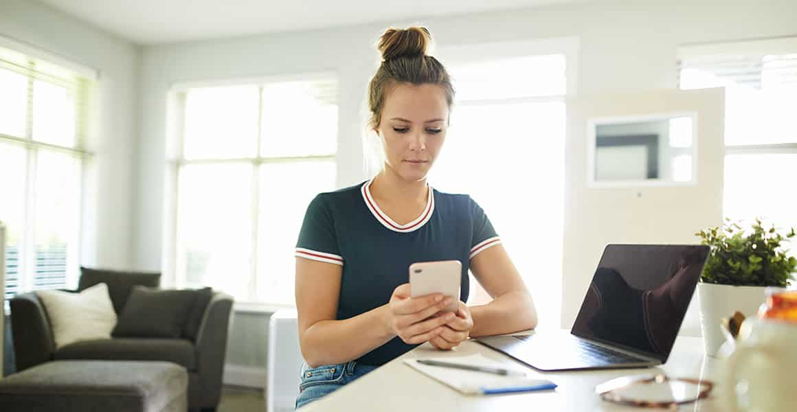 young woman with brown hair looking at your phone.