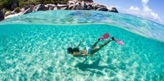 Snorkelling underwater pink snorkel