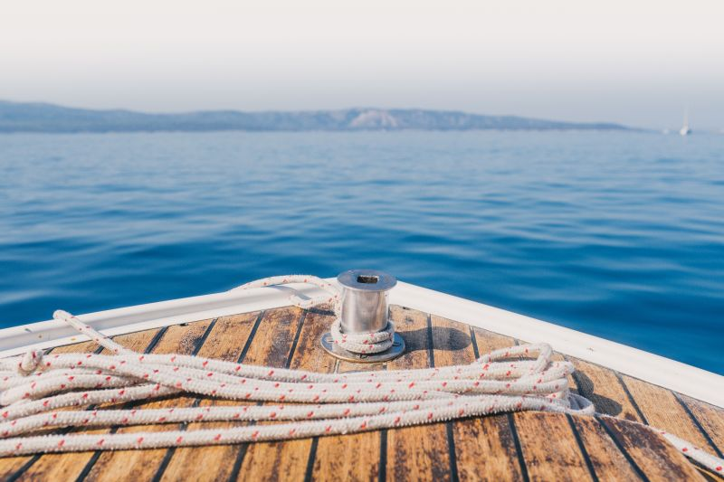 Sailing the high seas: learning basic nautical terms boat with rope on water