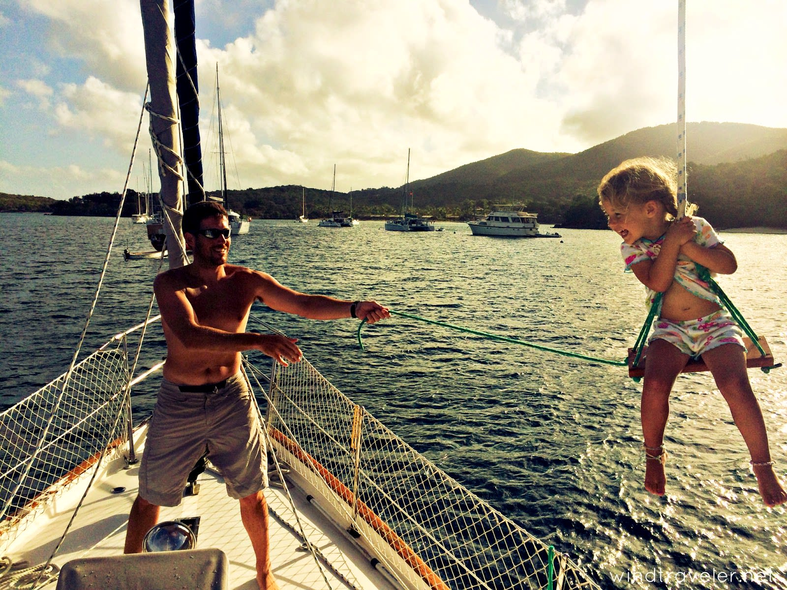 girl and dad on a sailing boat read the sailing blog