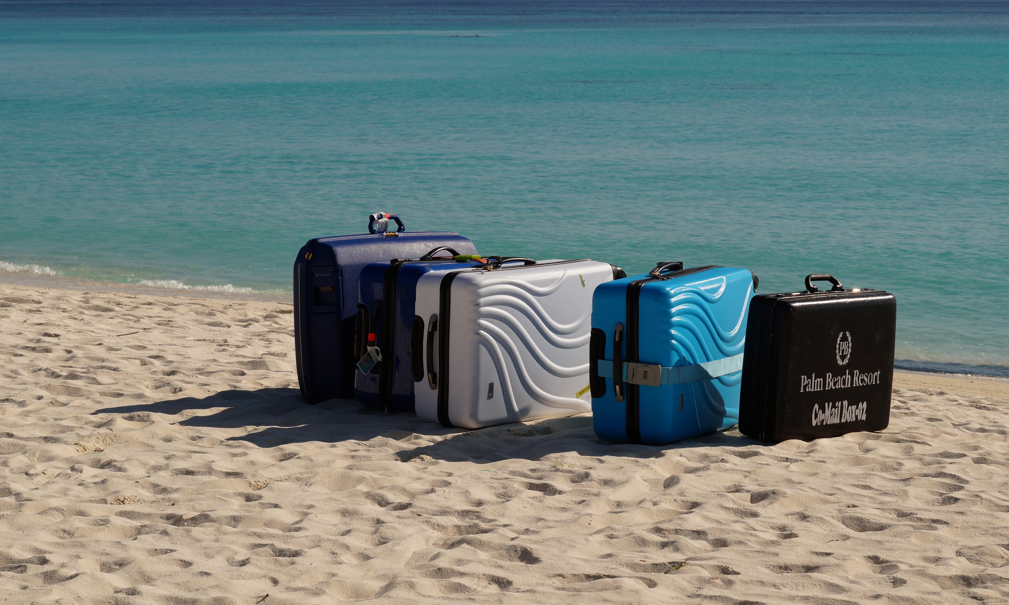 bags luggage on the beach