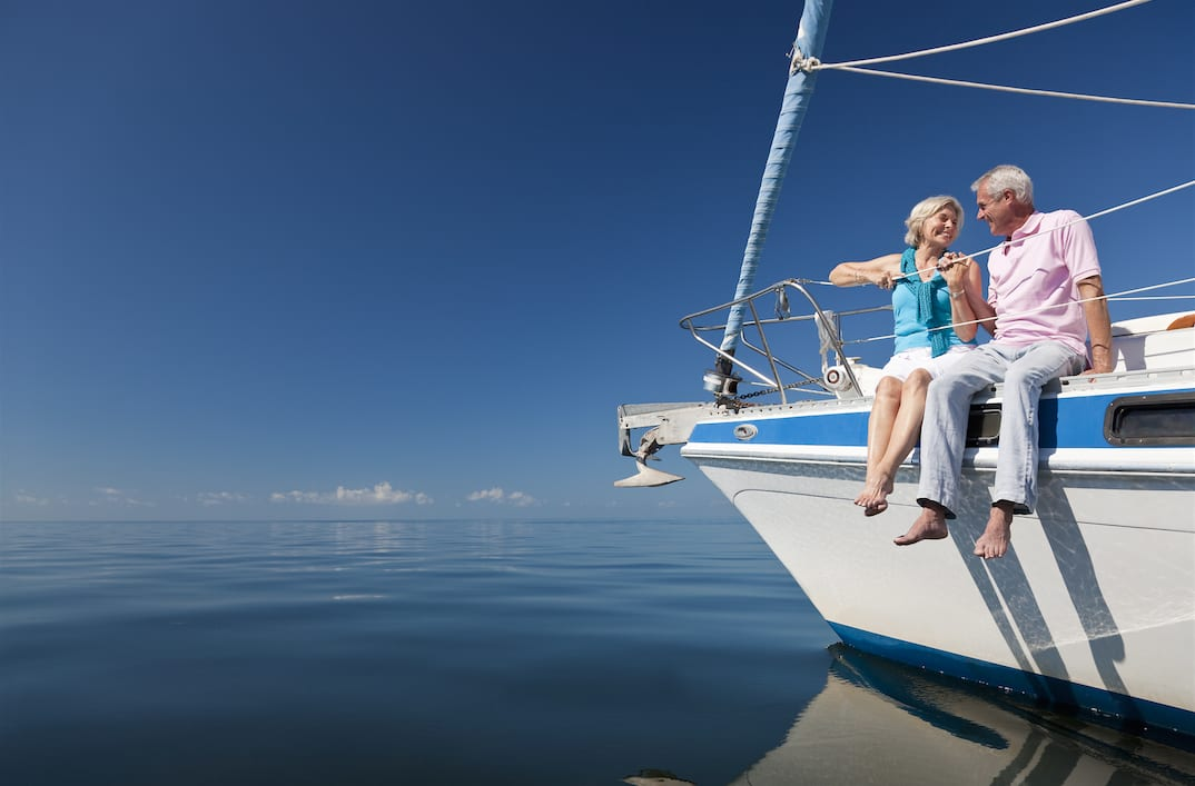 Older couple on a sailing holiday