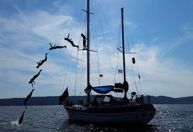 man diving off a sailing boat, travel blog interviews Zizoo