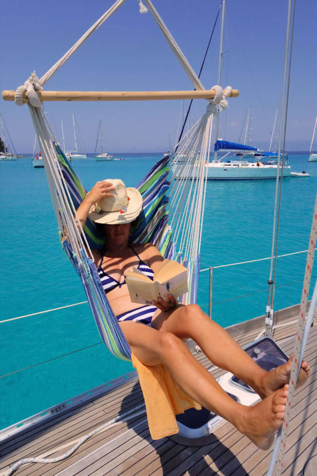 women-relaxing-on-a-yacht-deck
