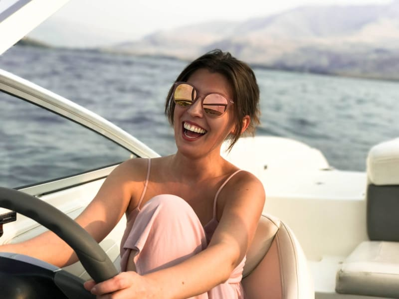 Sailing the high seas: the best yacht charter experience girl on boat